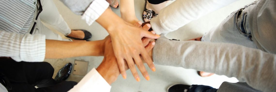 business-people-joining-hands