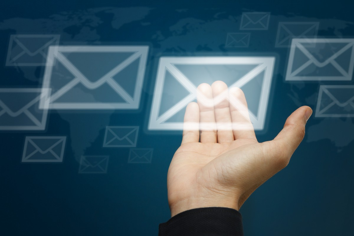 hand-carry-the-letter-icon-email-concept